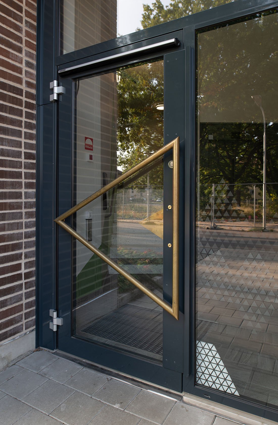 Triangulärt dörrhandtag